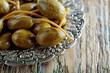 Leinwanddruck Bild - Pickled caper berries in metal dish .