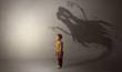 Leinwanddruck Bild - Scary ghost shadow in a dark empty room with a cute blond child