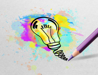 Drawing colorful bulb and multimedia symbols on white paper