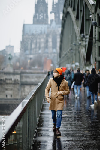 obraz lub plakat A man walks over the bridge. Cathedral Church of Saint Peter. Cologne Cathedral. Germany. Gothic architecture