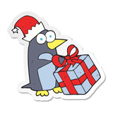 sticker of a cartoon christmas penguin