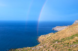 Fototapeta Tęcza - Wild hilly coastline of Creta island with a rainbow © tilialucida