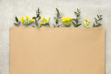 Crafted paper envelope decorated with Spring yellow primrose flowers and eucalyptus leaves