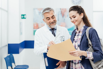 Doctor explaining medical records to his patient
