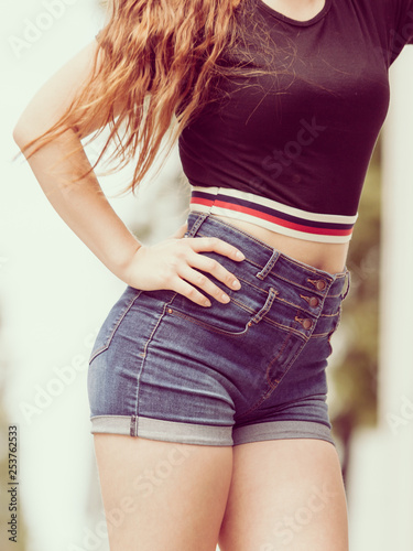 Female buttocks in denim shorts - 253762533