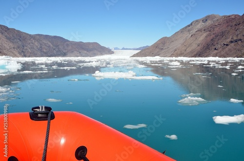 Sailing on an inflatable boat among the icebergs, Greenland © Alessandro