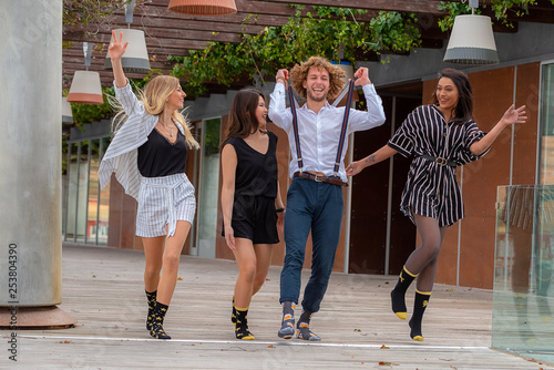 Leinwanddruck Bild young people having fun and jumping around
