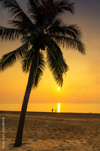 obraz PCV Silhouette palm tree, father and his son standing view at the sea during sunrise