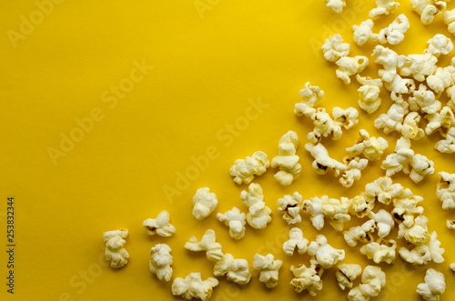 popcorn  on yellow paper background
