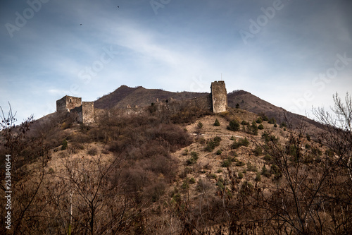 Ruins of medieval castle on top of hill near the river and road. Maglic in Serbia.