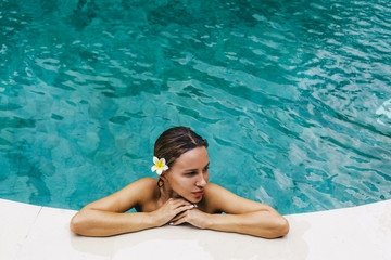 Woman relaxing in swimming pool © Alena Ozerova