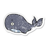 distressed sticker of a cartoon whale
