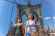 Girls having fun at New York, Brooklyn Bridge