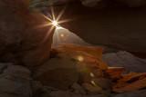 Burst of light through rocks