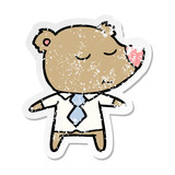 distressed sticker of a happy cartoon bear wearing shirt