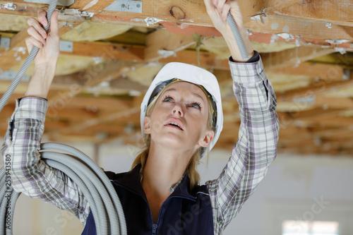 female carpenter at construction site