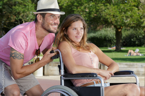 handicapped couple in the park outdoors
