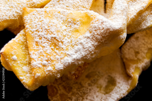 Angel wings:  traditional sweet crisp pastry for carnival time. Italian cenci, frappe, bugie or chiacchiere - 253949161