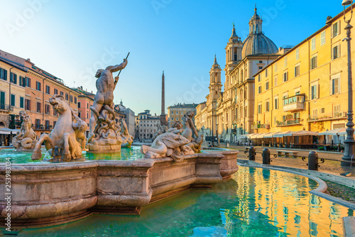 Navona Square or Piazza Navona in Rome, Italy with fountain. Rome architecture and landmark at sunrise - 253983134