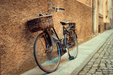 Old bicycle parking near old grunge street wall