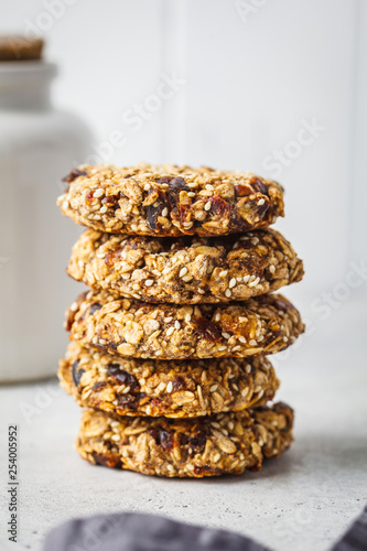 Stack of oatmeal cookies with dates. Healthy dessert concept. - 254005952