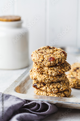 Leinwanddruck Bild Stack of oatmeal cookies with dates. Healthy dessert concept.