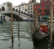 gondola moored on the Grand Canal near the Rialto Bridge in Veni