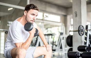 Portrait Caucasian handsome young man Are building muscles with exercise machines,healthy sports lifestyle, Fitness concept