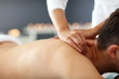 Leinwanddruck Bild - Handsome man having massage in spa salon