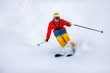 Man skier high speed rides on fresh snow, dust in air. Concept extreme winter sport
