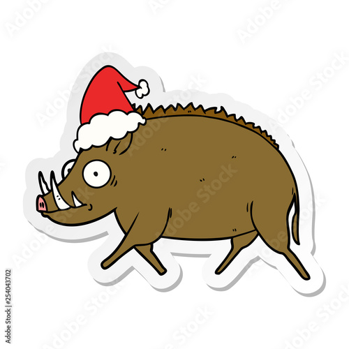 sticker cartoon of a wild boar wearing santa hat