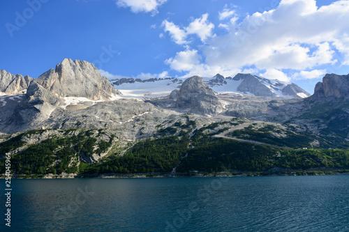 Leinwandbild Motiv the spectacular Lake of Fedaia at the base of the Marmolada glacier