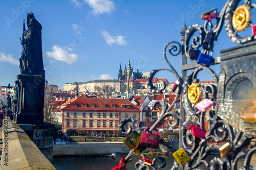 obraz lub plakat View of the Vltava River and the bridges shined with the sunset sun, Prague, the Czech Republic