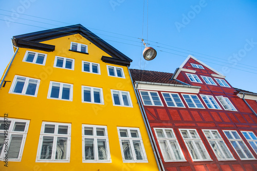 view to traditional colored houses under blue sky  in Copenhagen in Denmark - 254058712
