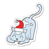 sticker of a cartoon cat wearing christmas hat
