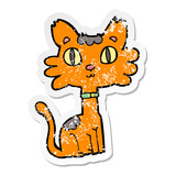 distressed sticker of a cartoon cat