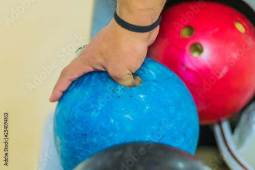 take blue bowling ball in hand