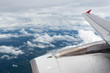 Above the clouds.Wing aircraft on the sky - 254105544