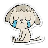 distressed sticker of a cute cartoon dog crying