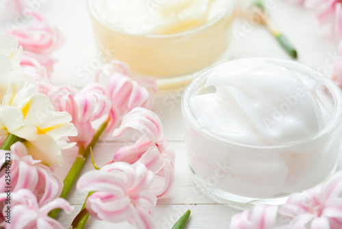 Moisturizers with hyacinth and daffodil flowers © tstock