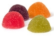 Four marmalade fruit candies on white background - 254164301