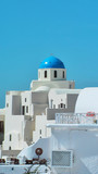 Beautiful day in santorini with clear sky and blue dome