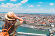 young stylish woman looking at panoramic view of budapest city