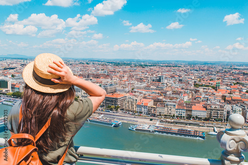 obraz lub plakat young stylish woman looking at panoramic view of budapest city