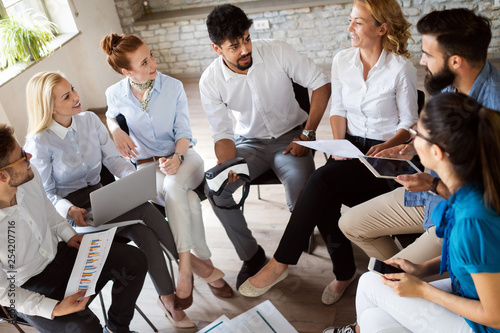 Group of business professionals having a meeting. Diverse group of designers smiling at the office. © nd3000