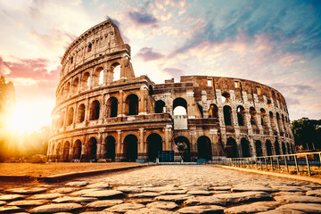 The ancient Colosseum in Rome at sunset © kbarzycki