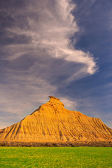 Plantation of cereals and cabezo of the curtains in the desert of the Bardenas, Navarra © poliki
