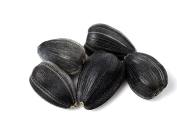 Few black sunflower seeds close up. isolated on a white background.