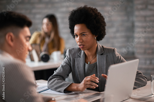 African American financial advisor having a meeting with client in the office.
