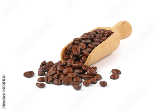 Wooden scoop of roasted coffee beans on white - 254258363